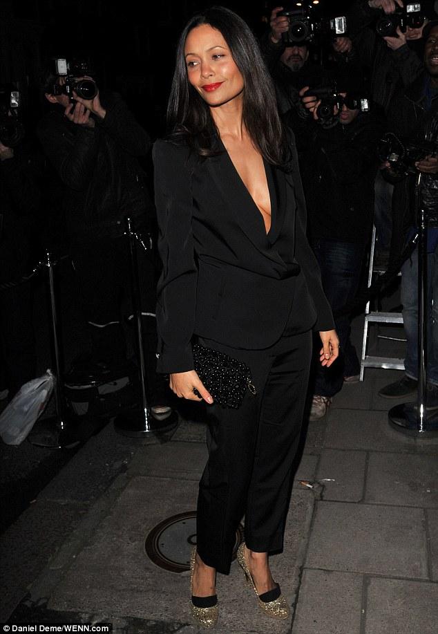 That's a bit daring! Thandie Newton shows off some skin with a plunging suit jacket as she arrives at Harper's Bazaar London Fashion Week closing party