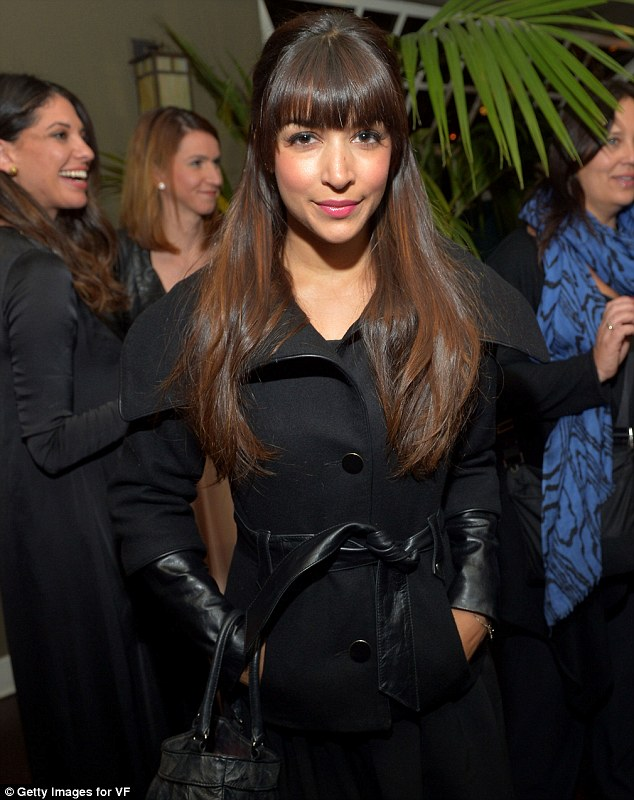 Black out: Actress Hannah Simone covered up in more conservative attire