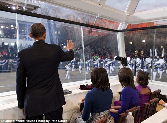 All grown up: As the First Family watch the inaugural parade from the reviewing stand Mr Souza gets a quick shot revealing the cut-out detailing on young Sasha's dress