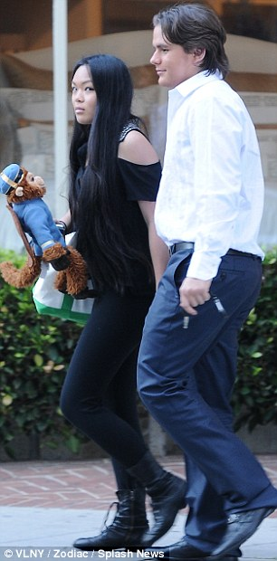 Monkey business: Niki was carrying a toy chimp