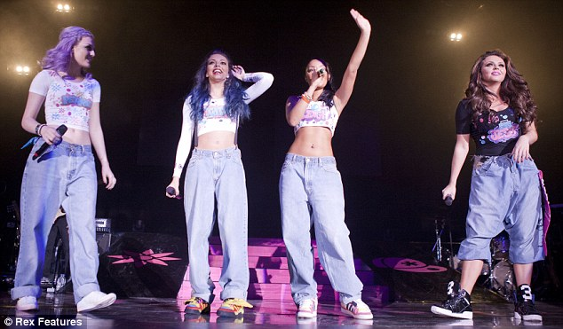 Stepping out of their comfort zone: Little Mix usually opt for far more casual attire and can be seen displaying their midriffs while wearing baggy jeans on stage in Cardiff, Wales this week