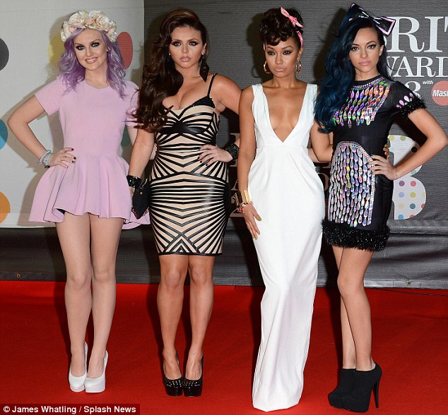 Changing styles: Little Mix appear to be moving with the times and altered their look by opting for dresses rather than ripped jeans at the Brit Awards in London on Wednesday