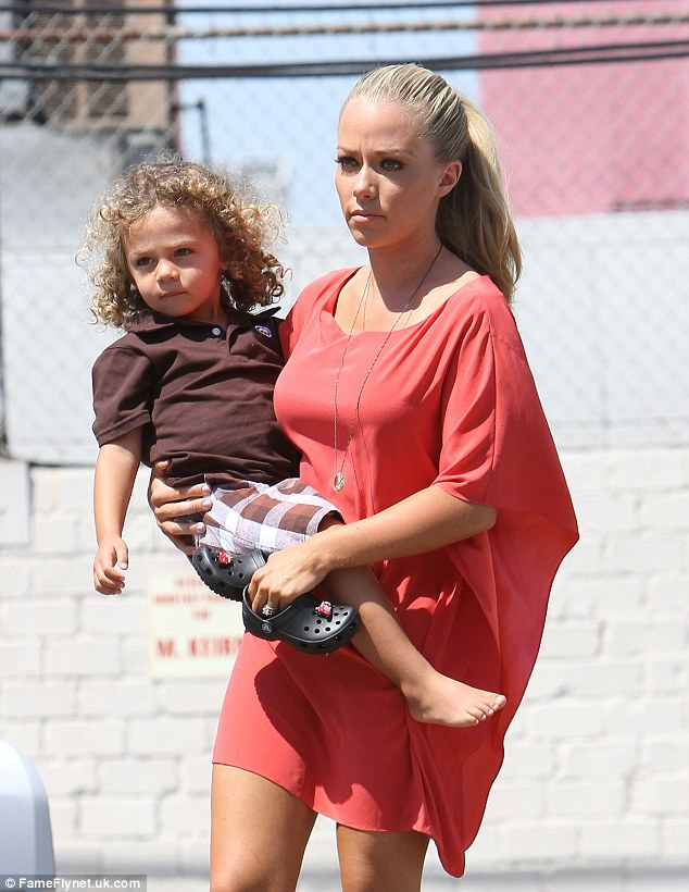 New role: Kendra Wilkinson had to think quickly on her feet when her three-year-old son Hank Jr. discovered an old naked Playboy photo of her