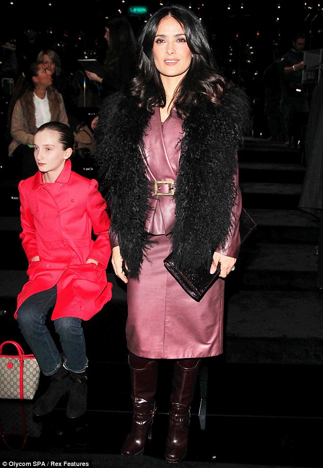 Lady in leather: Salma Hayek leads the fashion pack at Milan Fashion week in plum leather suit and co-ordinating knee-high boots