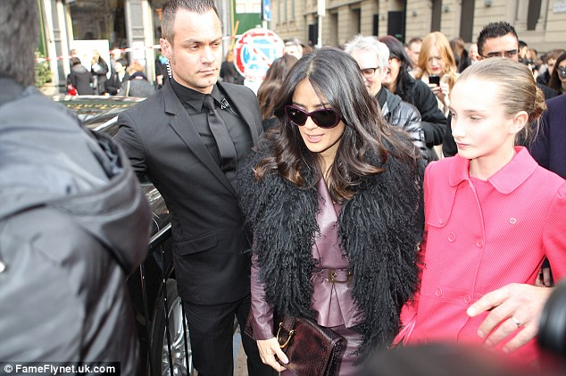Working it: She was ushered in by security as she went to watch the Gucci autumn/winter show in the Italian city