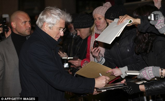 Fans: The white-haired actor was more than happy to stop and sign autographs for his waiting fans