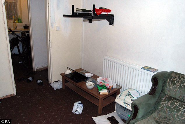Safe house: The trio were based at this property in White Street, Birmingham, and used as the headquarters for their terror cell. wonder if that book on the table is bomb making for Muslim dummies