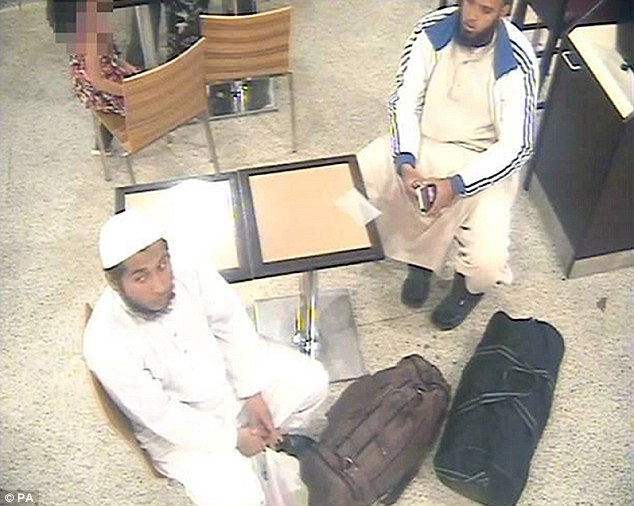 good dress sense. mix and match look. taliban and casual. Trips: Khobaib Hussain and Naweed Ali are shown here sitting and waiting for a flight from Birmingham Airport