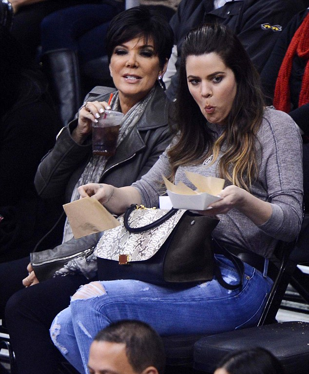 No need for silver service: Khloe Kardashian enjoyed a courtside dinner with her mother at the Los Angeles Clippers versus Dallas Spurs game in Los Angles, California, on Thursday