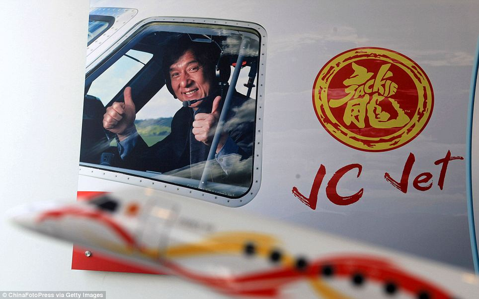 Thumbs up: Jackie Chan's plane is emblazoned with his name and personal logo