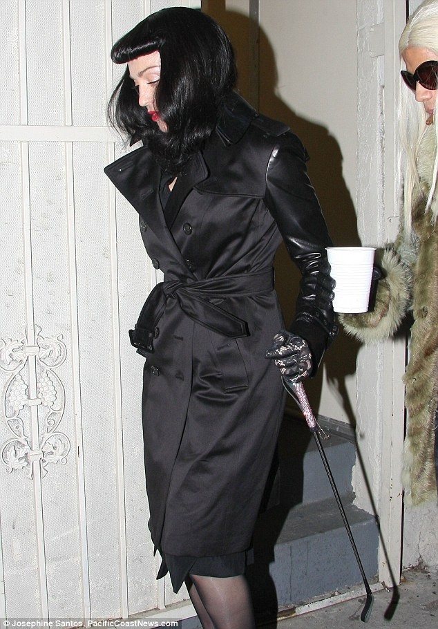 What A Switch Madonna Wears Black Fright Wig And Carries