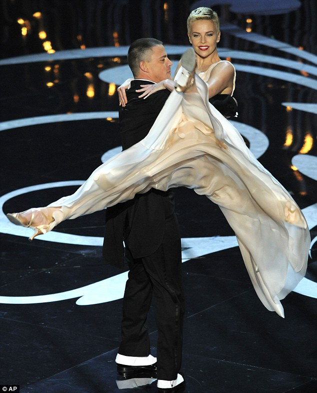 Impressive: Channing pulled off an impressive move when he lifted Charlize into the air during the dance