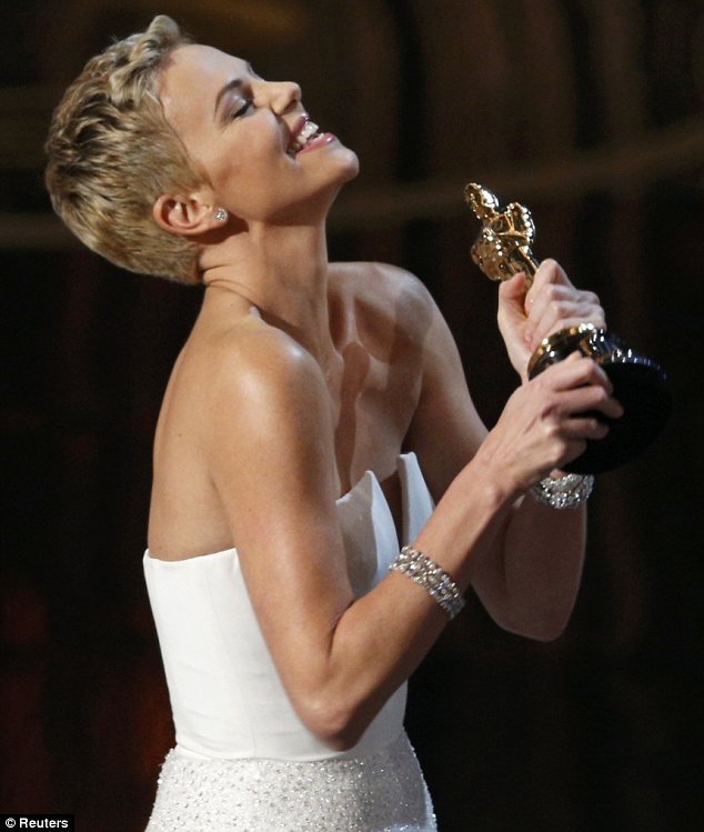 Congratulations: Charlize presented the Best Original Screenplay gong to Quentin Tarantino for Django Unchained