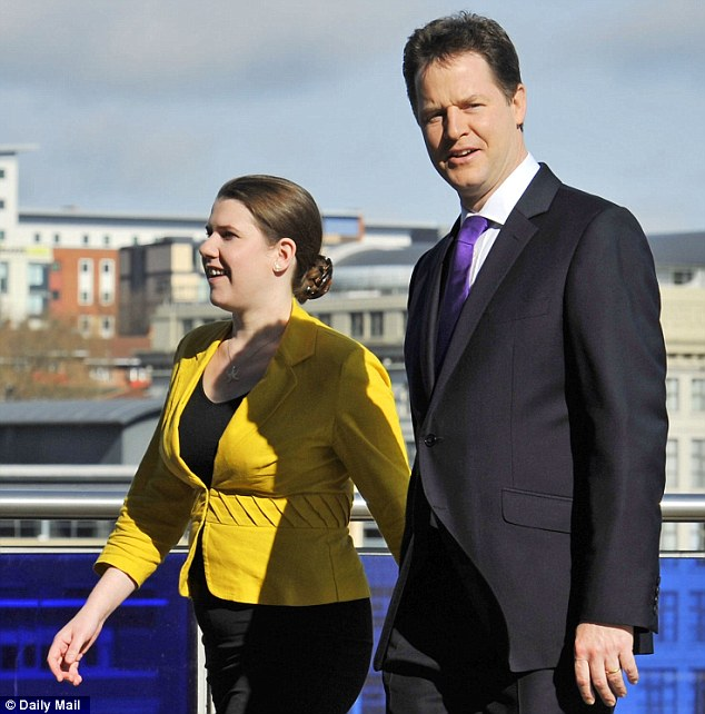 Questions to answer: Jo Swinson, left, pictured with Lib Dem leader Nick Clegg, right, is been named as a key figure in her party's handling of the allegations against Lord Rennard
