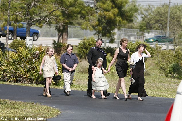 Unidentified funeral goers arrive for Mindy McCready's service at the Crossroads Baptist Church in Fort Myers, Florida