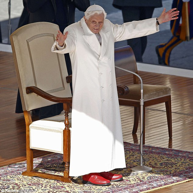 Farewell moment: Pope Benedict XVI waves to the huge crowd in St Peter's Square at his last general audience today