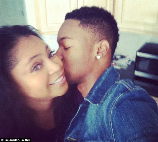 Affection: The Georgia-based, 16-year-old aspiring rapper is pictured with his mother