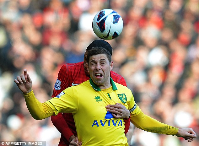 Tussle: Grant Holt tries to beat Chris Smalling (back) in the air