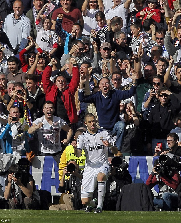 Karim Benzema celebrates scoring the opening goal
