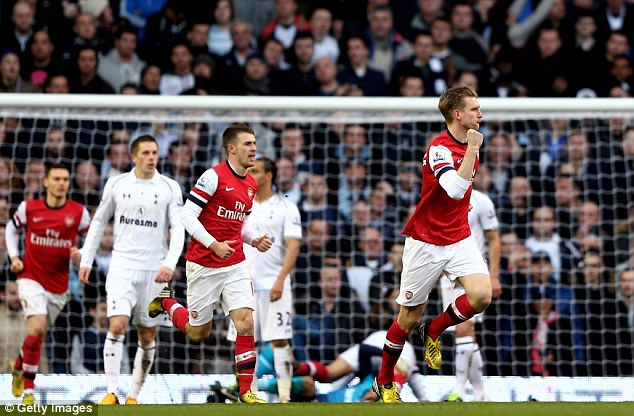 Back in it: Per Mertesacker celebrates after heading home for Arsenal to reduce their deficit