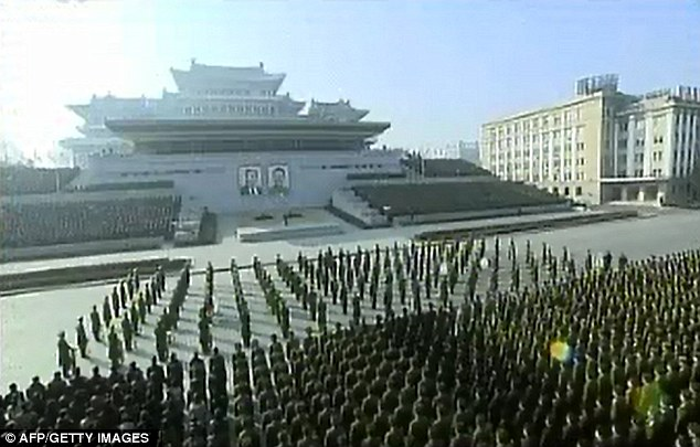 Show of strength: A mass rally of citizens and soldiers in the North Korean capital Pyongyang held after the regime threatened a 'pre-emptive' nuclear strike against the United States