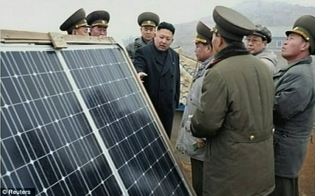 Looking at things: Kim admires a large solar panel installed by the North Korean regime