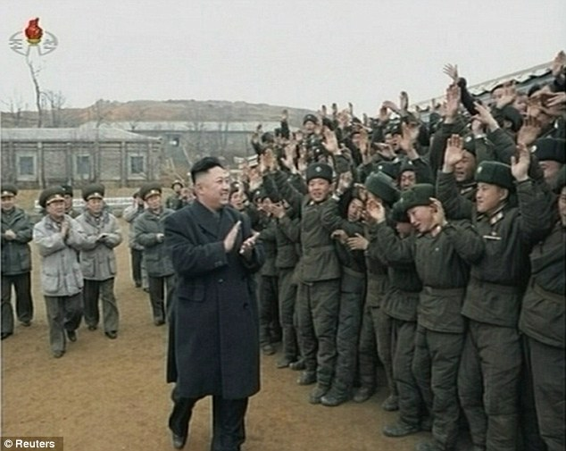 'Crushing strikes': Kim Jong-Un applauds as he is welcomed by members of the military at an undisclosed location, in a still image from footage broadcast by state media in North Korea today