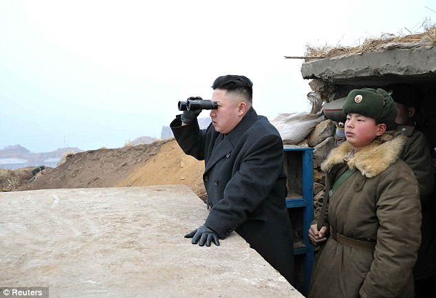 Anger: North Korean leader Kim Jong-Un, seen using binoculars to look towards the South in this picture released by state media, has scrapped the non-aggression agreement between the two countries