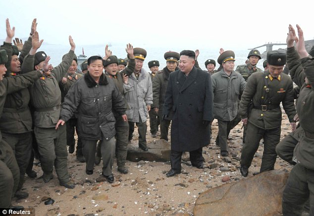 Preparing for war: Kim visited a group of soldiers on a military island near the border yesterday
