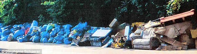 Eyesore: Piles of rubbish left by Romanian and Bulgarian immigrants in front of a tower block which houses up to 400 people