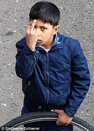 Bad attitude: A young Roma boy who is not attending school shows his reaction to being snapped