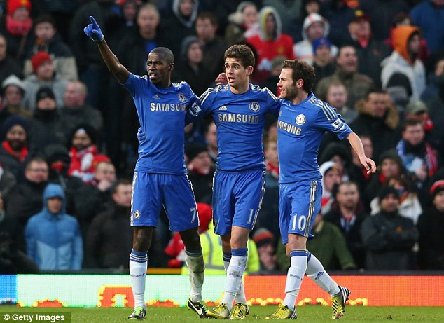 Banishing the blues: Ramires (left), Azpilicueta and Mata (right) salute the travelling army of Chelsea fans