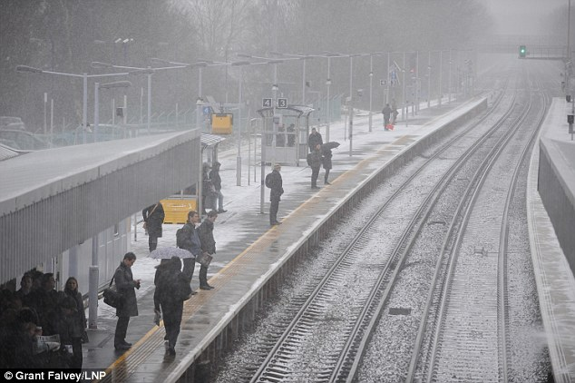 Cold for commuters: Spring snow was seen today at Petts Wood train station near Bromley in Kent