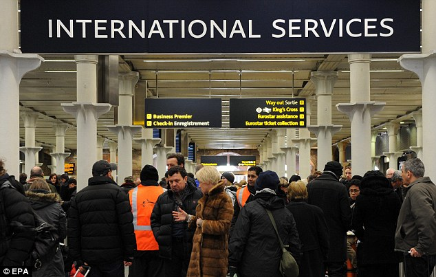 No movement: Stranded passengers wait at the Eurostar terminal at St Pancras International in London