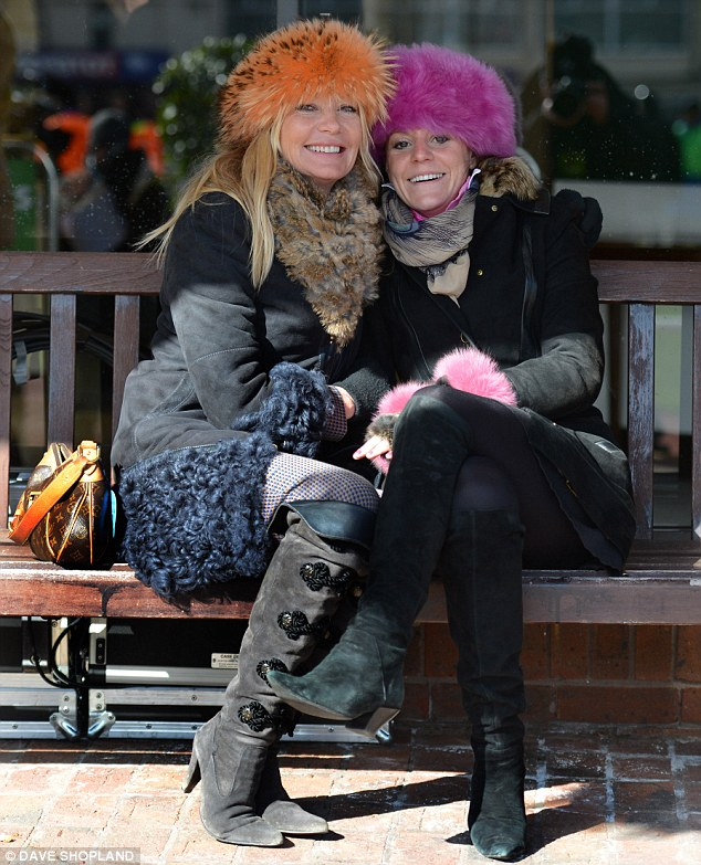Colourful: It was too cold for frocks and heels, so racegoers used bright hats to up the style ante