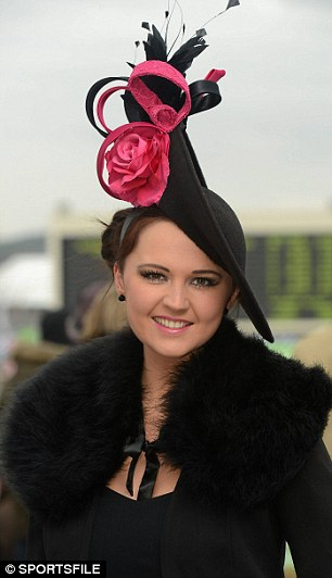 Heavenly hats: Despite the chilly weather, many racegoers chose to wear cheerful summery fascinators