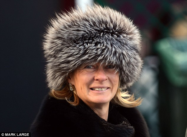 Snug: Racegoers made sure they were wrapped up warm on the first day of Cheltenham today