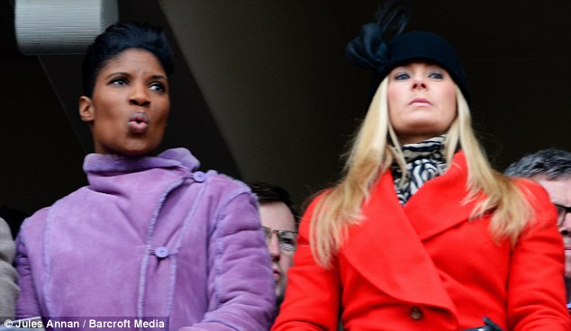 Backing a winner? Former sprinter Denise Lewis and a friend look on as Hurricane Fly triumphs in the Champion Hurdle