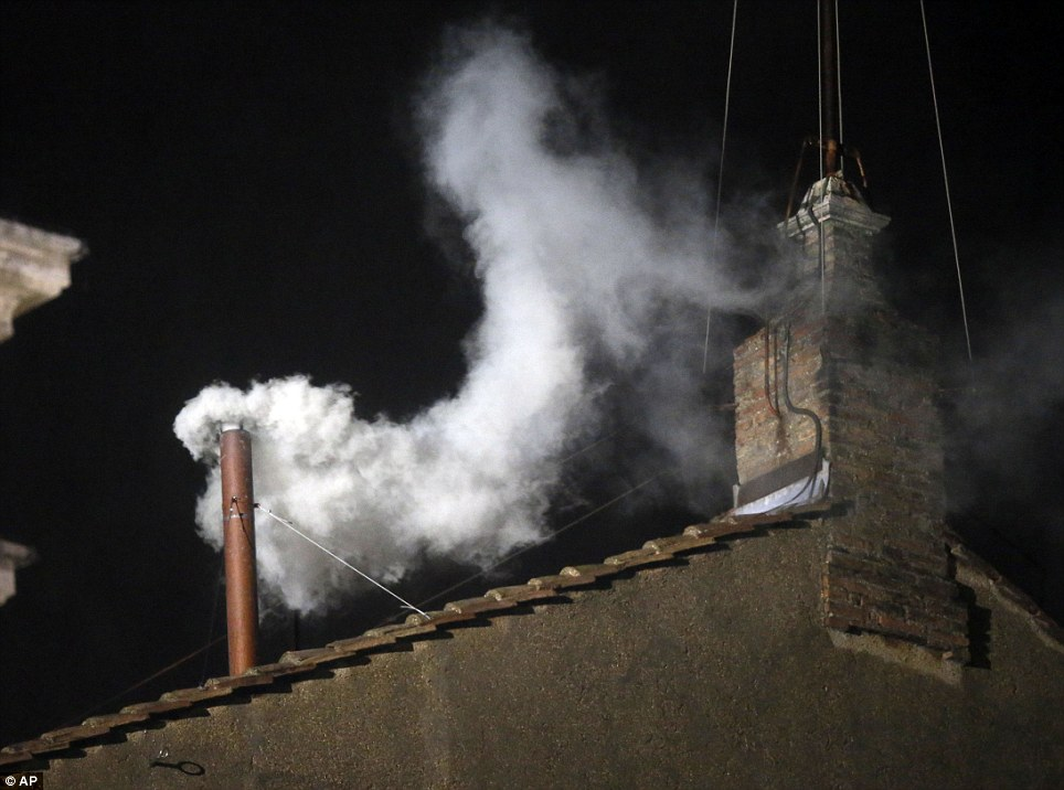 Applause: As the white smoke emerged from the chimney, thousands of Catholics burst into applause at the unexpected decision