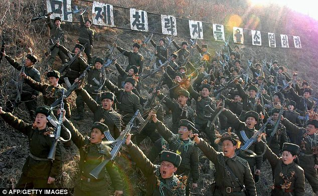 Warlike: North Korean members of the Worker-Peasant Red Guards shouting anti-U.S. slogans