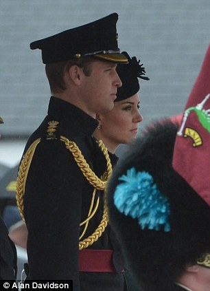 Standing to attention: The Royal couple stood for the national anthem, left
