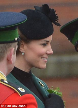 while Kate recycled the same coat she wore to last year's event
