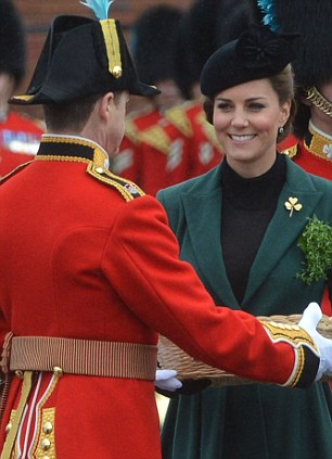and Kate, wearing a gold shamrock smiles she presents the traditional sprigs of shamrocks