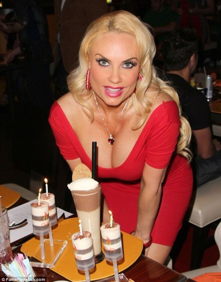 Make a wish: Coco wore a typically low cut red dress as she arrived at Gordon Ramsey's BurGR at Planet Hollywood restaurant