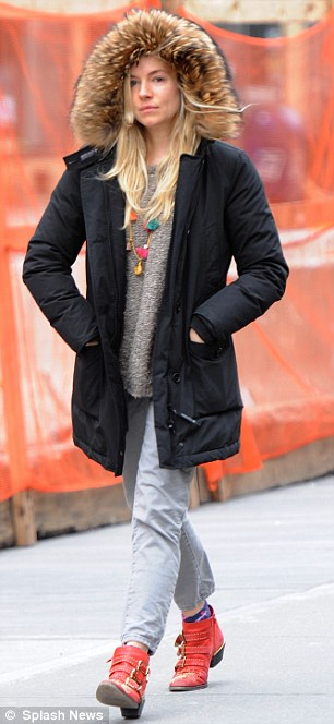 Sienna Miller Cuts A Cool Figure As She Steps Out In Red