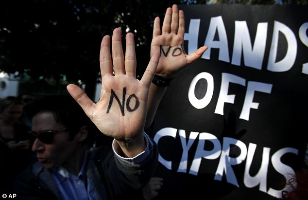 Protesters outside the Cypriot parliament in Nicosia