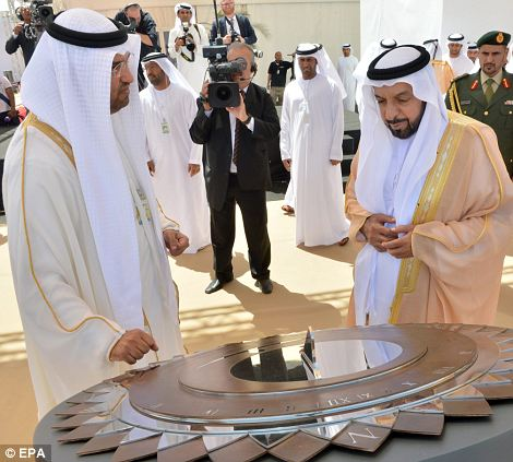 President Nahyan (right) chats with Dr Al Jaber: By concentrating heat from direct sunlight onto oil-filled pipes, Shams 1 produces steam, which drives a turbine to generate electricity.