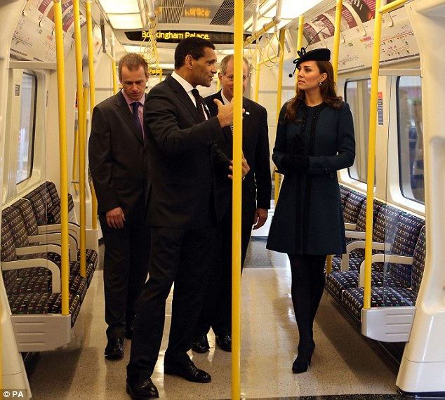 Personal service: The Duchess of Cambridge is given a tour of tube carriage displaying its next stop as Buckingham Palace