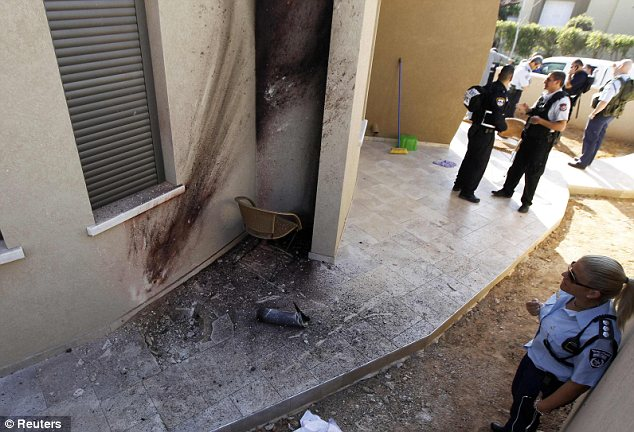 Damage: The house in Sderot where a rocket fired from Gaza fell on Thursday