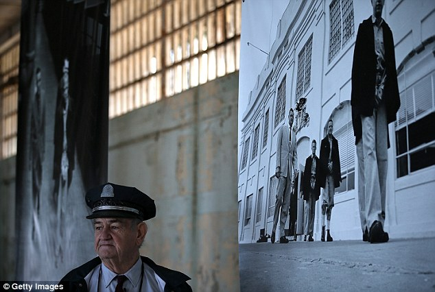 Former Alcatraz Island prison guard Jim Albright looks on while viewing an exhibit of photographs documenting the last day of Alcatraz federal penitentiary today